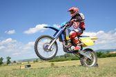 Motocross rider on a practice field — Stock Photo