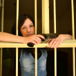 Female Criminal Behind Bars — Stock Photo