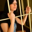 Стоковое фото: Female Criminal Behind Bars