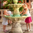 Girls play by Fountain — Stock Photo