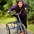 Woman Riding Trike — Stock Photo #30906041