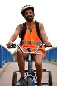 Man Riding Tricycle — Stock Photo