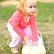 Little girl eating corn nibbles — Stock Photo #31248225