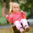 Baby girl in swing — Stock Photo