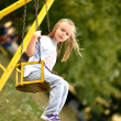 Girl playing on the swing — Stock Photo