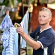 Stock Photo: Man hanging clothes
