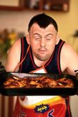 Man with down syndrome eating barbecue — Stock Photo