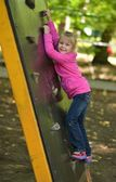 Girl play on a park playground — Stock Photo