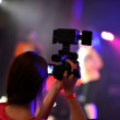 Woman recording the concert — Stockfoto
