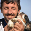 Mwith his pet dog — Stock Photo #34735063