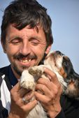 Man with his pet dog — Stock Photo