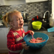 Little girl cooking — Stock Photo