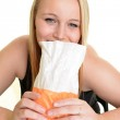 Sick woman with paper bag — Stock Photo