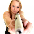 Young beautiful woman holding a gun — Stock Photo