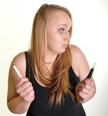 Woman holding e-cigarette — Stock Photo