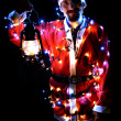 Christmas theme with Santa holding magical lights in hands — Stock Photo