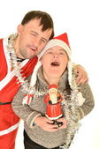 Down syndrome couple in Christmas time — Stock Photo