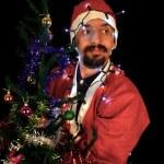 サンタの手で幻想的な灯りを保持 — ストック写真