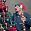 Man decorating the Christmas tree — Stock Photo #37297915