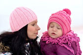 Mother and daughter nice winter scene — Stock Photo