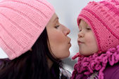 Mother and her little daughter enjoying beautiful winter day outdoors — Stock Photo