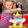 Stock Photo: Girl playing toy kitchen