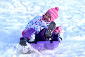 Happy girl Sledding, winter fun, snow, family sledding — Stok fotoğraf