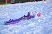 Happy girl Sledding, winter fun, snow, family sledding — Foto de Stock