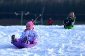 Happy girl Sledding, winter fun, snow, family sledding — Photo