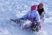 Sledding, winter fun, snow, family sledding — Stock Photo