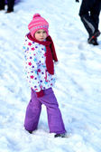 Portrait of happy girl in winter fun, snow, family sledding — Photo