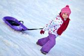 Happy girl Sledding, winter fun, snow, family sledding — Stock Photo