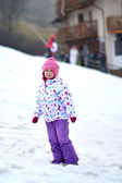 Portrait of happy girl in winter fun, snow, family sledding — Stok fotoğraf