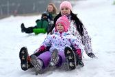 Sledding, winter fun, snow, family sledding — Stok fotoğraf