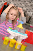 Girl playing toy kitchen — Stock Photo
