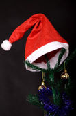 Christmas background decorated tree with santa hat on it — Stock Photo