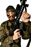 Soldado furioso con arma sobre fondo blanco — Foto de Stock