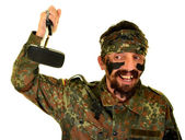 Man Soldier with broken cell phone — Stock Photo