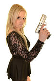 Beautiful young woman with gun — Stock Photo