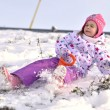 Portrait of happy girl in winter sledding — Stok fotoğraf