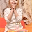 Cute little girl and birthday cake — Stock Photo