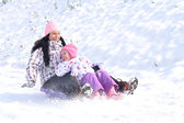 Winter fun - family sledding — Stock Photo