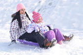 Winter fun - family sledding — ストック写真