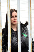 Woman behind the bars — Stock Photo