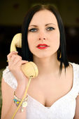 Lovely woman with a phone. — Стоковое фото
