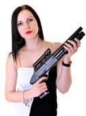Woman with a gun — Stock Photo