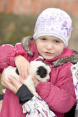 Baby holding puppy Jack Russel — Stock Photo