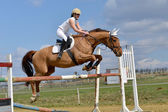 Woman at jumping show — Stock Photo