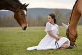 Bride and horses — Stock Photo