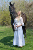 Bride and a horse. — Stock Photo